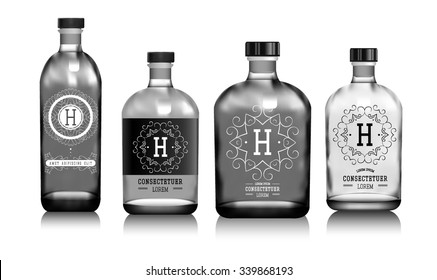Realistic vector glass bottles for alcohol such as vodka, cognac, whiskey. Transparent packing for alcoholic beverages with sticker, label. Mock up.