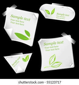 realistic vector stickers with peeling corners and green leafs