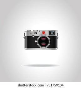 Realistic vintage style retro photo camera with shiny red lens. Vector illustration isolated on gray