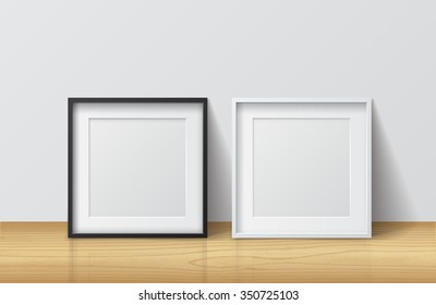 Realistic White and Black Blank Square Picture frame, standing on Light Wood Floor at White Wall from the Front.  Design Template for Mock Up. Vector illustration