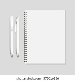 Realistic white pen and spiral notepad mockup vector illustration