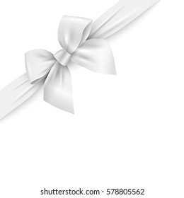 Realistic white ribbon with bow on white background. Vector decorative design element.