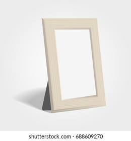 Realistic wooden picture or photo frame mock up standing on light background. Vector design template.