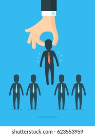 Recruitment concept. Large hand picking right choice from the businessmen silhouettes group. Vector illustration in simple flat style.
