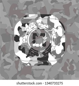recycle icon inside grey camouflage texture