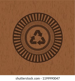 recycle icon inside wood emblem