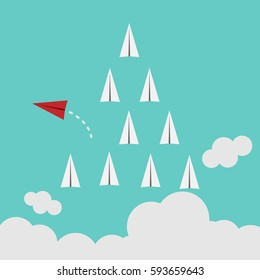 Red airplane changing direction and white ones. New idea, change, trend, courage, creative solution, innovation and unique way concept.