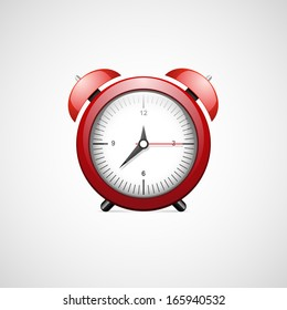 Red alarm clock isolated on white.