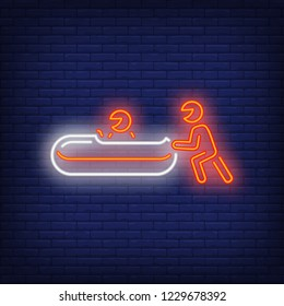 Red bobsleigh team neon sign. Glowing bob with sport team on dark blue brick background. Can be used for sport, winter games, Olympic
