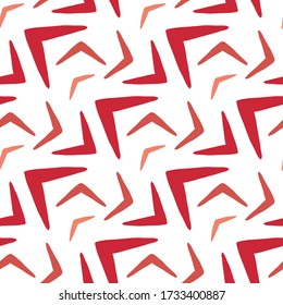 Red boomerangs isolated on a white background. Geometric seamless pattern. Hand drawn vector graphic illustration. Texture.