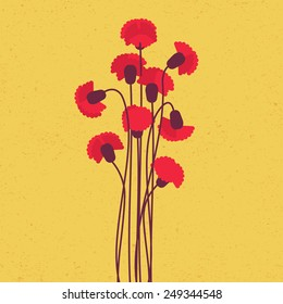Red carnation bouquet with branch on yellow background
