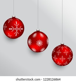 Red christmas balls with snowflake pattern and silver hangers. Set of holiday ornaments.