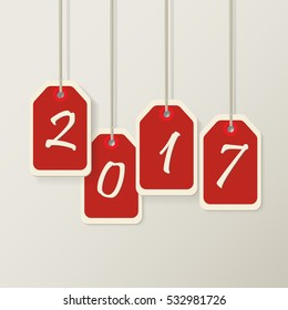 Red color hanging tags paper. Happy new year 2017 concept.