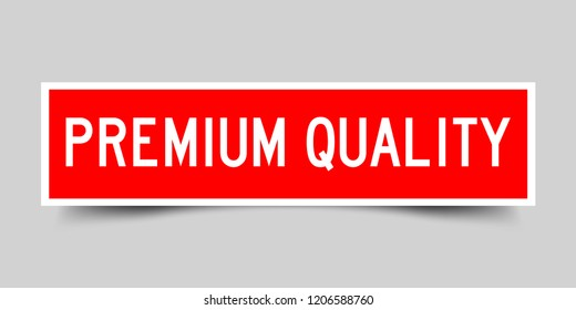 Red color sticker in word premium quality on gray background