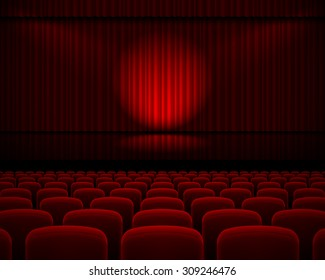 Red curtain from the theatre with a spotlight and row chairs
