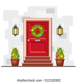 Red front door on the gray brick wall with two green plants, a holiday wreath with christmas balls and lights. Cute bright vector x-mas illustration. Cartoon house element. Cozy winter picture.