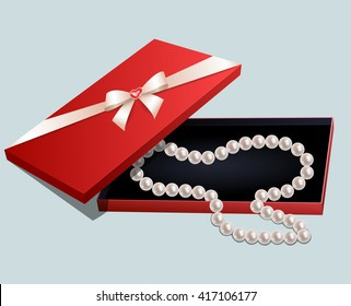 Red gift box with a pearl necklace on gray background