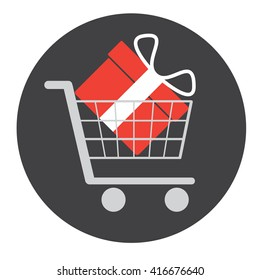 Red gift box in shopping cart on a grey background