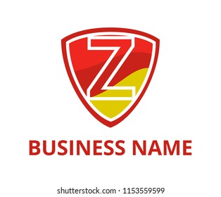 red and gold color simple triangle shield logo graphic design with modern clean style for protection or security company with initial type letter z on it
