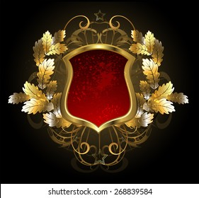 Red, gold shield with golden oak branch on black background.
