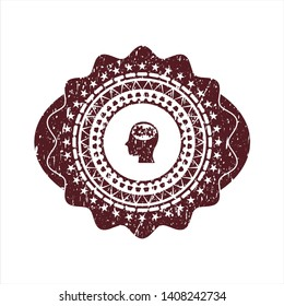 Red head with gears inside icon inside distressed rubber grunge texture stamp