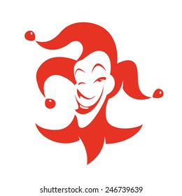 Red joker with a sly look and a smile. Vector hand drawn illustration - clown in hat with bells.