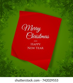 Red Merry Christmas sheet of paper placed on green background with snowflakes
