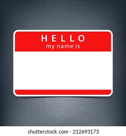 Red name tag blank sticker HELLO my name is. Rounded rectangular badge with black drop shadow on gray background with noise effect texture. Vector illustration clip-art element for design in 10 eps