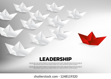 Red origami paper ship leading the group of white. Business Concept of team leadership.