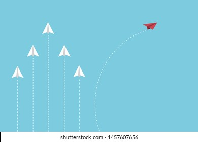 The red paper flying out from white paper planes group, think difference concept.