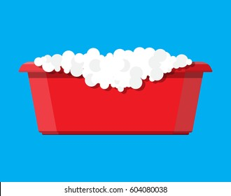 Red plastic basin with soap suds. Bowl with water. Washing clothes, cleaning equipment. Vector illustration in flat style