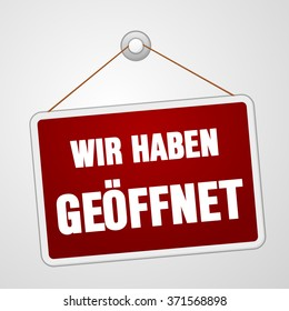Red rectangular wir haben geoffnet open sign hanging on string and pin over white background - in English saying We are Open