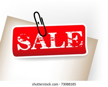 Red sale tag with paper clip
