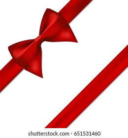 Red satin ribbon with bow on white background.