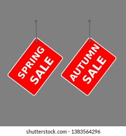 "red sign ""spring sale"" and ""autumn sale"" tag on dark background."