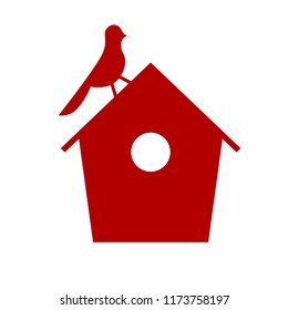 red silhouette of a birdhouse