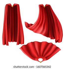 Red superhero cape, cloak with golden pin front and top view. Flying and fluttering on wind silk clothes for king, illusionist or vampire costume. Set of realistic mantle isolated on white background