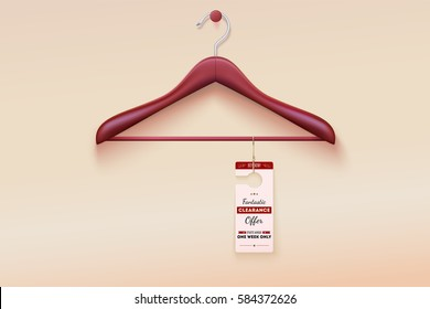 Red tag with special offer sign hanging on wooden hanger. Wooden hanger with tag and the message about the sale offers