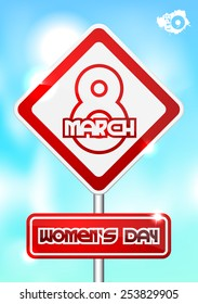 Red traffic sign with the inscription March 8 Women's Day on a blue background