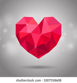Red triangle or polygonal heart. Valentine's day, Mother's day, Wedding day symbol on shiny background
