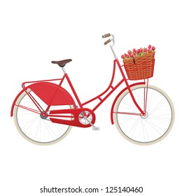 Red vintage ladies bicycle with wicker basket filled with tulips
