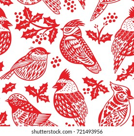 Red and white seamless Christmas pattern with ornamental birds and mistletoe. Wrapping paper texture for winter holidays