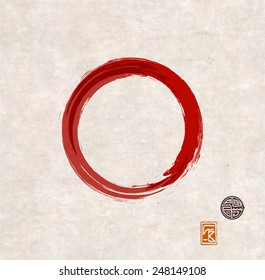 Red zen circle on vintage rice paper with decorative stamps. Red circle hand-drawn with ink.