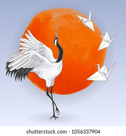 The red-crowned Japanese dancing crane and white paper origami birds over sunset