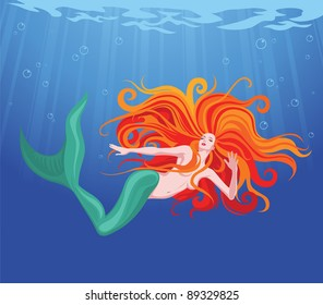 Red-haired beauty mermaid swim in sea water