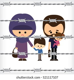refugee family facing the barbed wire fence