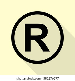 Registered Trademark sign. Black icon with flat style shadow path on cream background.
