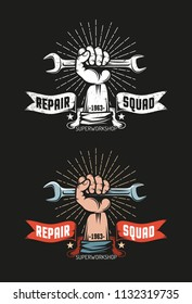 Repair workshop logo in vintage style. The hand holds  wrench. Heraldic ribbon with inscriptions. Black background. Color and monochrome versions. Grunge worn texture on separate layer.