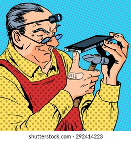 The repairman phones smartphone humour mechanic engineer gadgets programmer. A grown man with tools is holding a modern gadget, and is going to beat it with a hammer