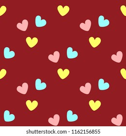 Repeated coloured hearts. Cute seamless pattern. Simple romantic print. Red, pink, yellow, turquoise. Vector illustration.
